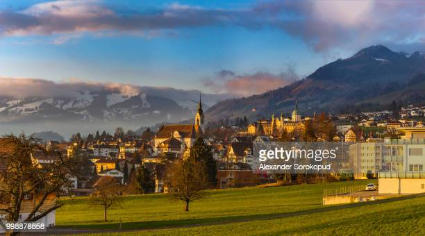 colorful sunset in schwyz. switzerland. wide-angle hd-quality pa - schwyz stock pictures, royalty-free photos & images