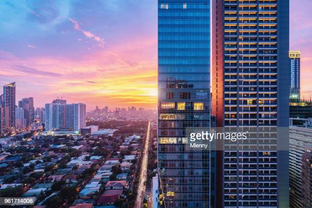 colorful sunset makati skyscraper metro manila philippines - manila philippines stock pictures, royalty-free photos & images