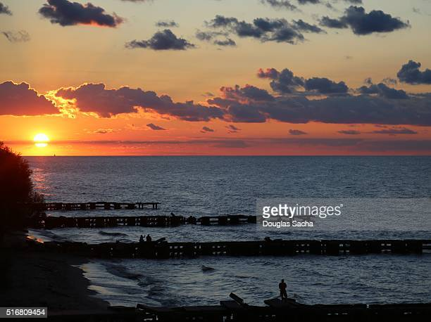 colorful sunset on the lakeshore of multiple piers, Edgewater park, Cleveland Ohio, USA