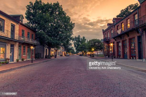 colorful sunset over historic district of saint charles missouri - missouri stock pictures, royalty-free photos & images