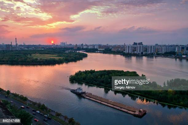 colorful sunset over nature parkland in moscow - barge stock photos and pictures