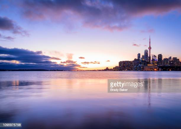 colorful sunset over toronto city skyline in winter - toronto stock pictures, royalty-free photos & images