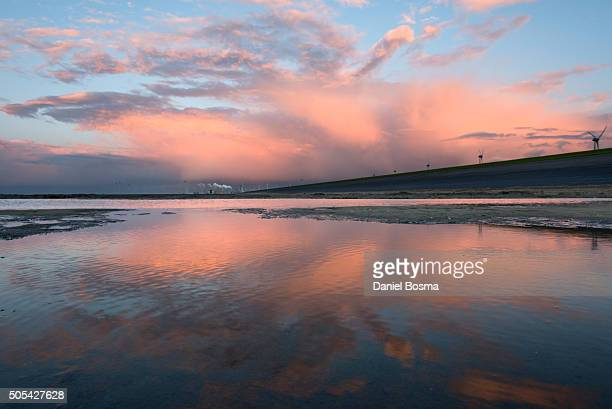 Colorful sunset reflected at Dutch northcoast