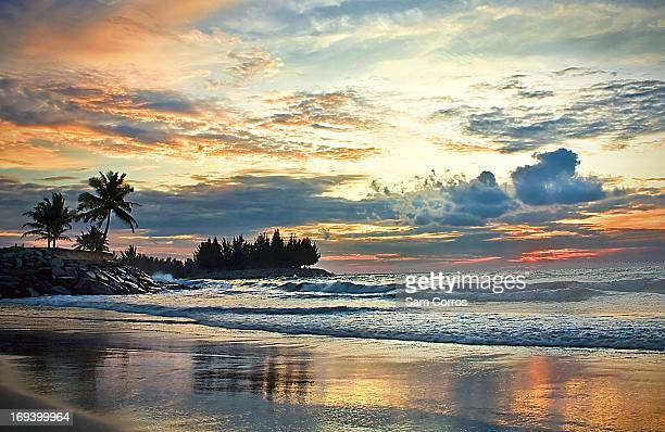 Colorful sunset reflected on a wet shoreline