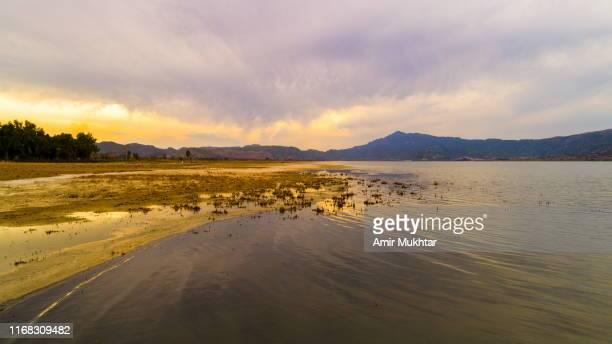 colorful sunset reflection in lake - punjabe - fotografias e filmes do acervo
