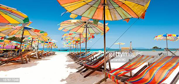 Colorful sunshade and chairs on beach