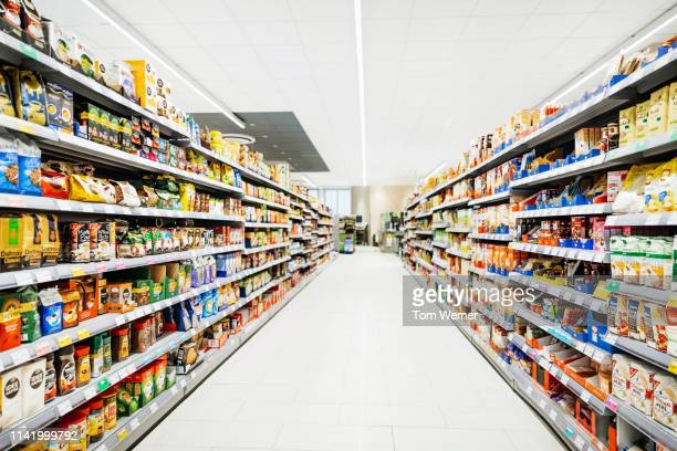 a colorful supermarket aisle - groceries stock pictures, royalty-free photos & images