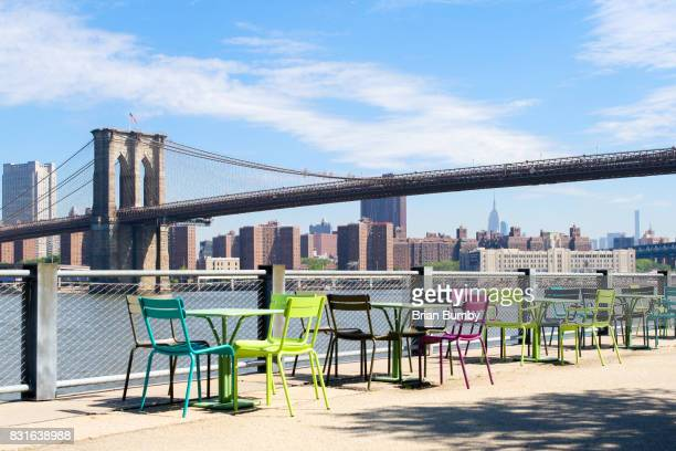 Colorful table and chairs in Brooklyn Bridge Park