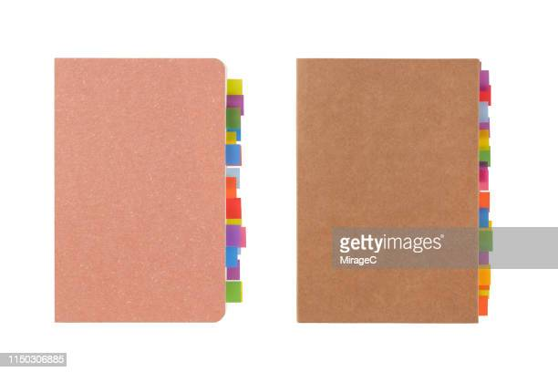 colorful tags at the edge of note pad - textbook stock pictures, royalty-free photos & images