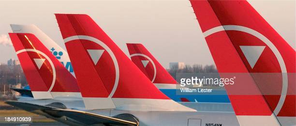 Colorful tail markings from Northwest Airlines and KLM line up at Schiphol Airport in Amsterdam, Netherlands