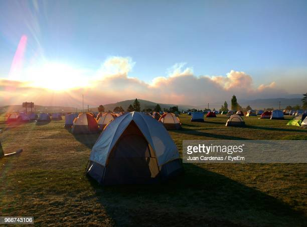 colorful tents on field during sunny day - tent stock pictures, royalty-free photos & images