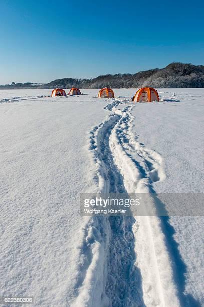 Colorful tents used for ice fishing on frozen Lake Abashiriko near Abashiri a city on Hokkaido Island Japan