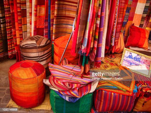 colorful textiles for sale at market stall - 売り出し中 ストックフォトと画像
