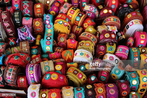 Colorful textiles for sale at vendor's stall in a street market. Barcelona, Spain