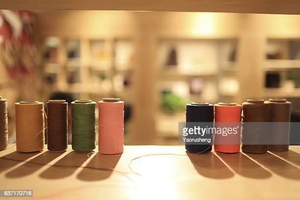 Colorful thread spools on the shelf