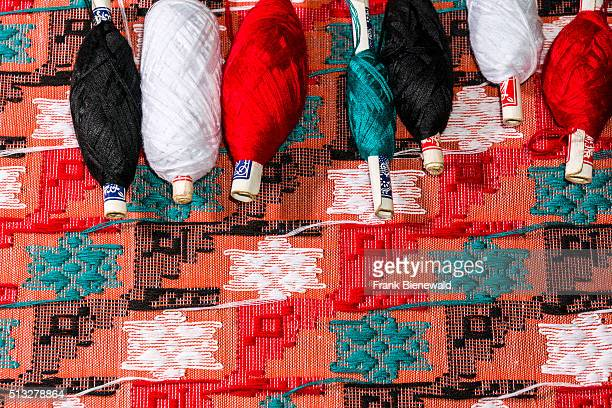 Colorful threads are used at the old traditional looms for weaving the material for the Dhaka topi the traditional nepali hats