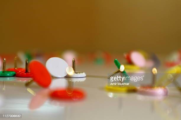 colorful thumb tacks or pins also known as paper or chart pins - as stock pictures, royalty-free photos & images