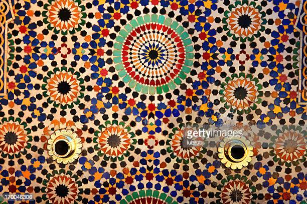 colorful tiles on fountain, mausoleum of mohammed v , rabat, morocco. - mosque hassan ii stock photos and pictures