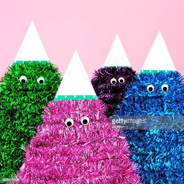 colorful tinsel characters with google eyes - tinsel stock pictures, royalty-free photos & images