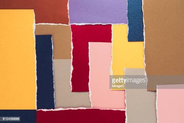 colorful torn paper abstract pattern - capas superpuestas fotografías e imágenes de stock