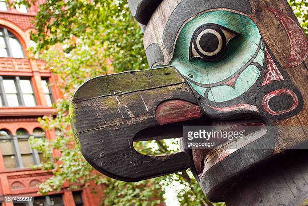 colorful totem pole at pioneer square in seattle, wa - totem pole stock pictures, royalty-free photos & images