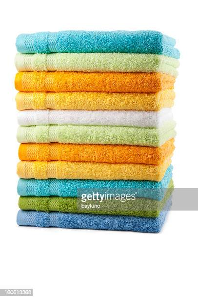 colorful towels placed in a stack - folded stock photos and pictures