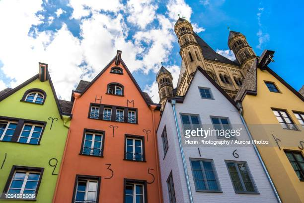 colorful townhouses, cologne,north rhine westphalia, germany - cologne stock pictures, royalty-free photos & images