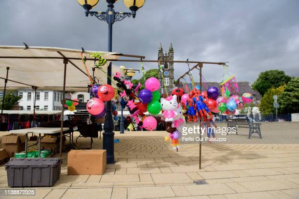 colorful toy balloon for sell at street market of bantry, country cork, ireland - feifei cui paoluzzo stock pictures, royalty-free photos & images
