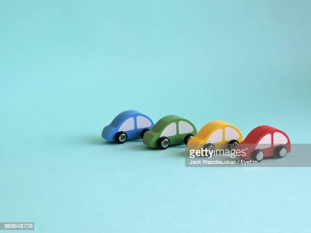 colorful toy cars on blue background - toy car stock pictures, royalty-free photos & images