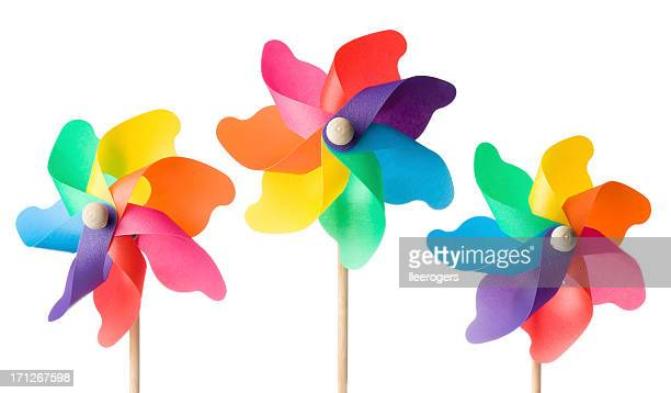 Colorful toy windmills on a white background