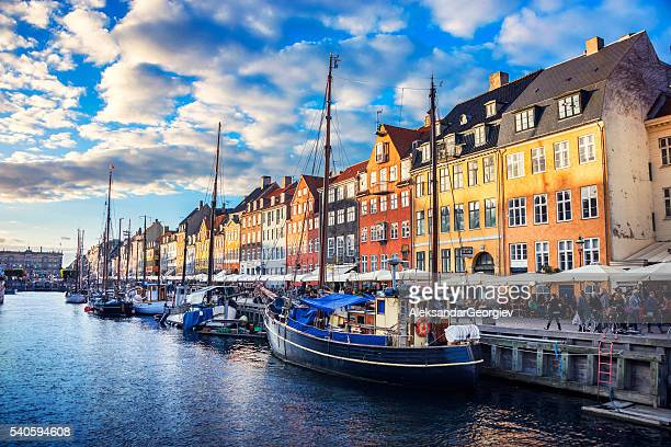 colorful traditional houses in copenhagen old town nyhavn at sunset - denmark stock pictures, royalty-free photos & images