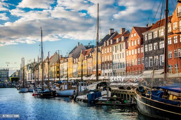 colorful traditional houses in copenhagen old town nyhavn at sunset - nyhavn stock pictures, royalty-free photos & images