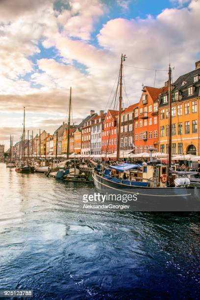 colorful traditional houses in copenhagen old town nyhavn at sunset - copenhagen stock pictures, royalty-free photos & images