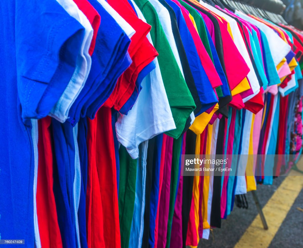 Colorful Tshirts Hanging In Rack At Market For Sale Stock-Foto ... ddb76adc7b
