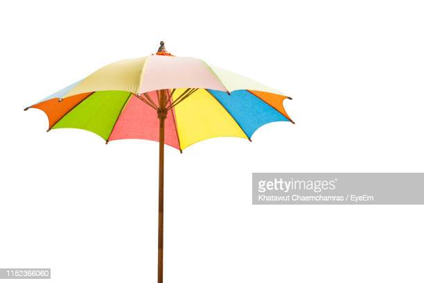 colorful umbrella against white background - parasol stock pictures, royalty-free photos & images