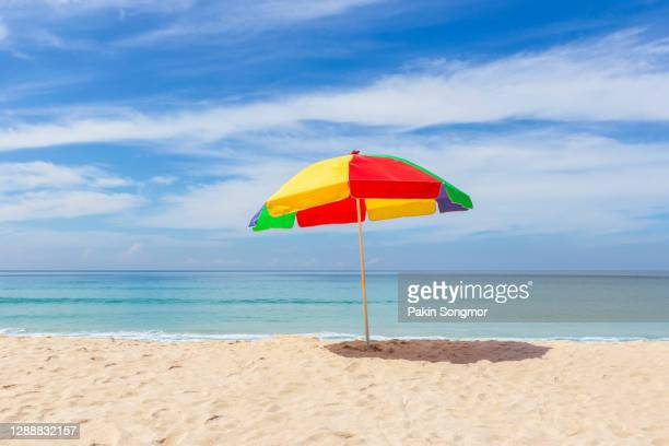 colorful umbrella and white sand beach in sunshine day at patong beach, phuket island, thailand. nature and travel concept - parasol stock pictures, royalty-free photos & images