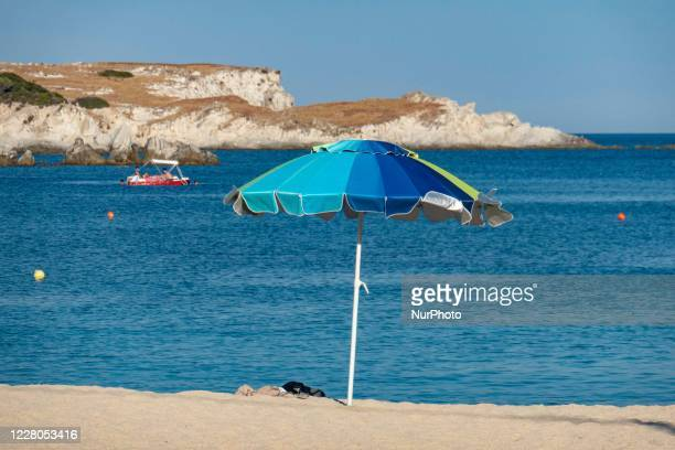 Colorful umbrella at the beach. Crowd of tourists at the popular and famous beach of Kalamitsi located on the southern tip of Sithonia peninsula in...
