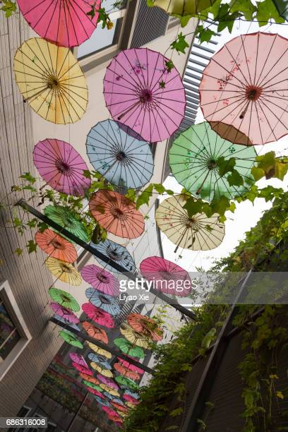 colorful umbrella - liyao xie stock pictures, royalty-free photos & images