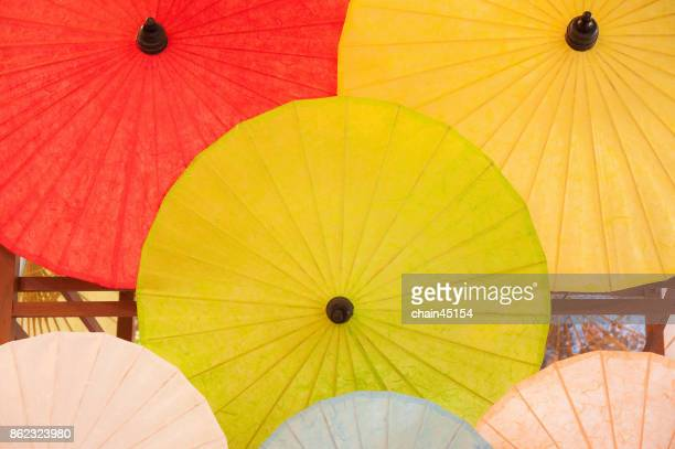 Colorful umbrellas background. Paper of umbrellas on the backdrop. Street decoration.