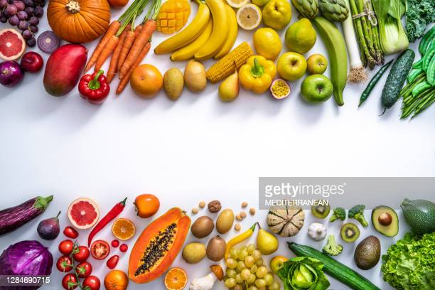 colorful vegetables and fruits vegan food in rainbow colors isolated on white - fruit stock pictures, royalty-free photos & images