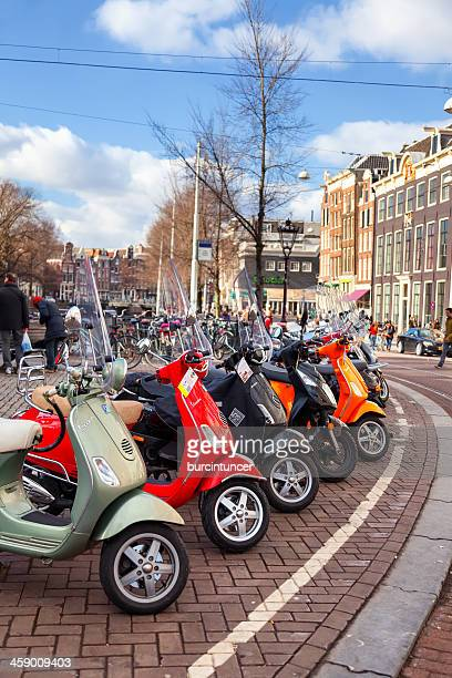 colorful vespa scooters parked in a row, amsterdam - vespa brand name stock pictures, royalty-free photos & images