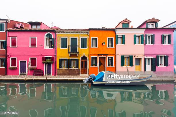 colorful vibrant houses along the canal on burano island near venice, italy - veneto stock pictures, royalty-free photos & images
