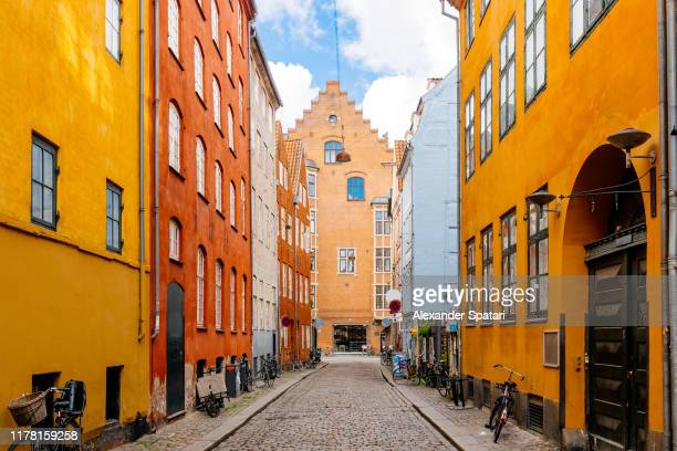 colorful vibrant street in copenhagen, denmark - copenhagen stock pictures, royalty-free photos & images