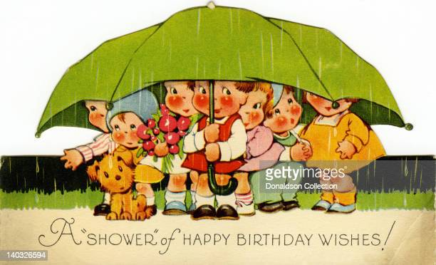 A colorful vintage cartoon greeting card depicts a group of small children huddling under a large unbrella with a dog and reads 'A 'shower' of...