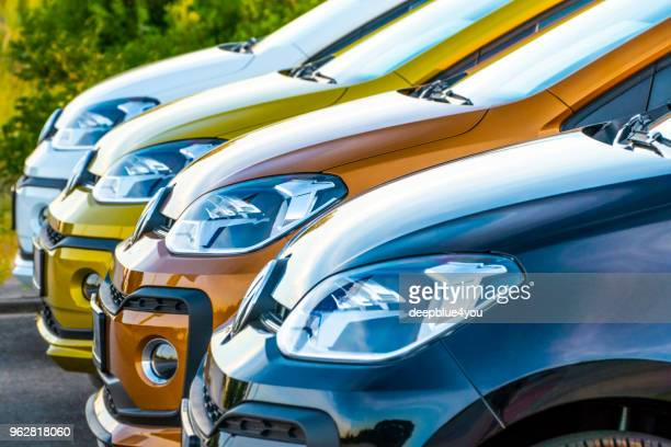 colorful vw up! cars in a row - compact car stock photos and pictures