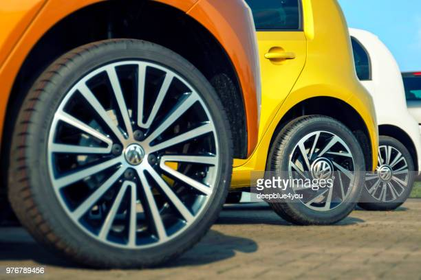 colorful vw up! cars - parked in a row - volkswagen stock pictures, royalty-free photos & images
