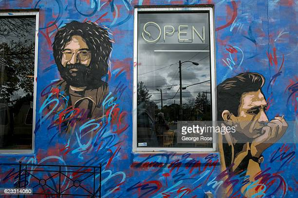 A colorful wall mural adorns a building in the quirky West Asheville neighborhood as viewed on October 22 2016 in Asheville North Carolina Named one...