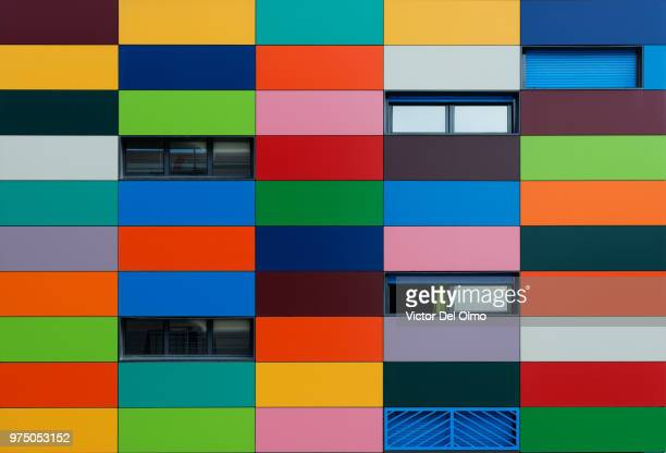 colorful wall with windows, vallecas, madrid, spain - rectangle stock pictures, royalty-free photos & images