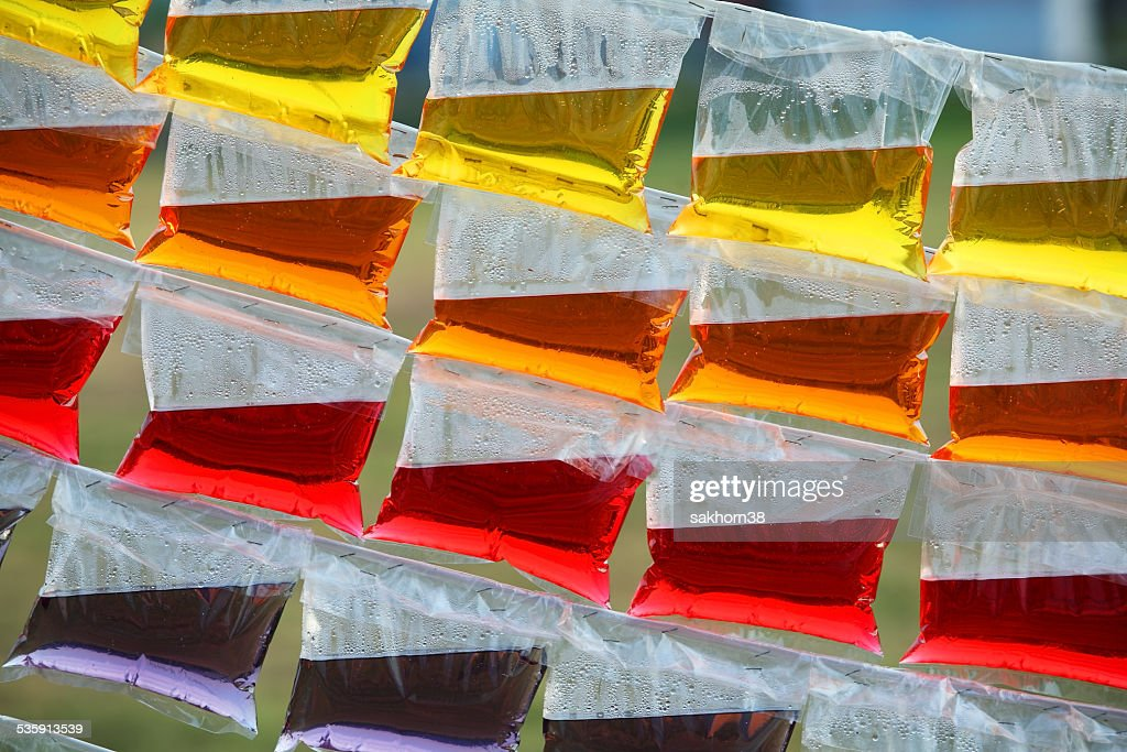 Colorful water in the plastic bag : Stock Photo