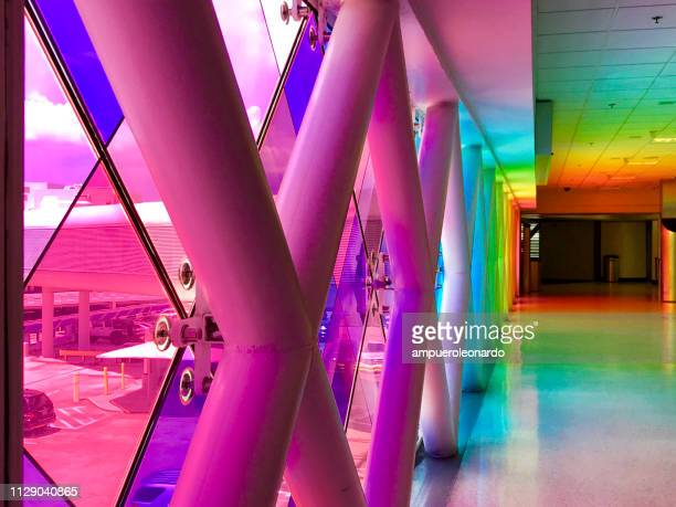 colorful windows in the miami international airport - miami dade county stock photos and pictures